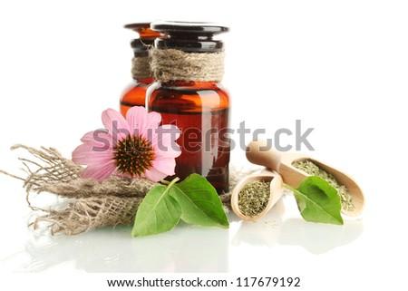 medicine bottles with purple echinacea , isolated on white - stock photo