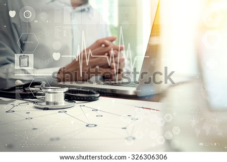 Medicine doctor hand working with modern computer interface as medical network concept                                - stock photo