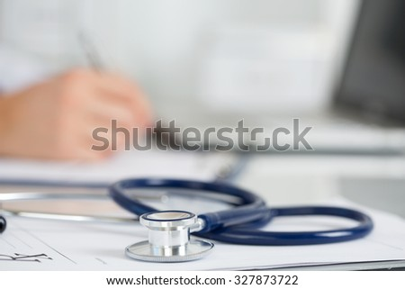 Medicine doctor's working table. Focus on stethoscope. Male medicine doctor operating on background. Healthcare and medical concept Copyspace - stock photo