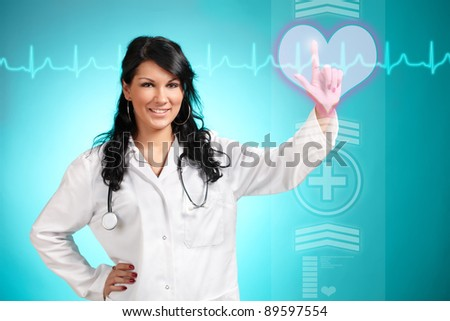 Medicine doctor working with futuristic interface, she is choosing heart symbol to do cardiac test for his patient. - stock photo