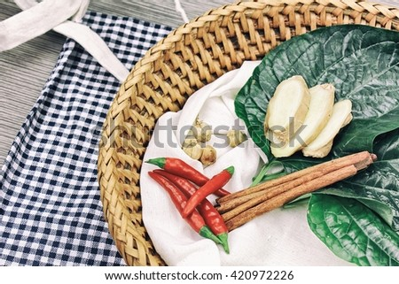 Medicine food, Cooking ingredients, Herbs and spice, ginger, cinnamon, cardamom, chlli, betel leaf. (Color Process) - stock photo