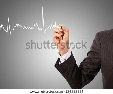 Medicine, hand drawing heart graph - stock photo