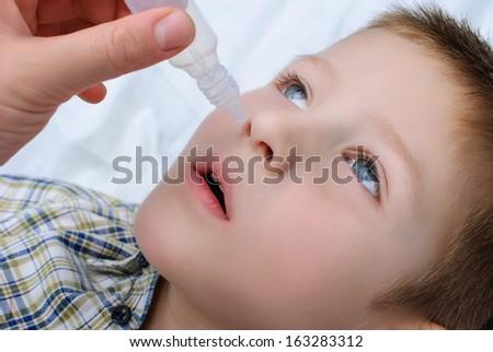 Medicine healthcare nasal dropper applying child  - stock photo