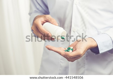 Medicine, hospital. Doctor with pills - stock photo