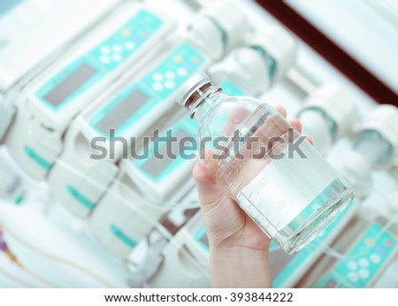 Medicine in hand on the background of equipment. - stock photo
