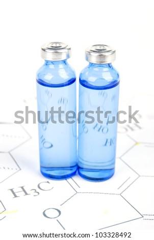 Medicine on chemical formula - stock photo