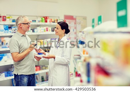 medicine, pharmaceutics, health care and people concept - happy pharmacist giving drug to senior man customer and taking prescription at drugstore - stock photo