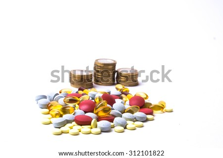 Medicine pills or capsules with money on white background. Pharmacy business, drug cost. Cash currency, expensive bill. Finance concept of pharmaceutical medication. Euro coins. - stock photo