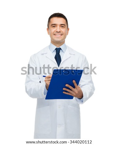 medicine, profession and healthcare concept - smiling male doctor with clipboard writing prescription - stock photo