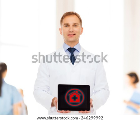 medicine, profession, and healthcare concept - smiling male doctor with tablet pc computer over group of medics - stock photo