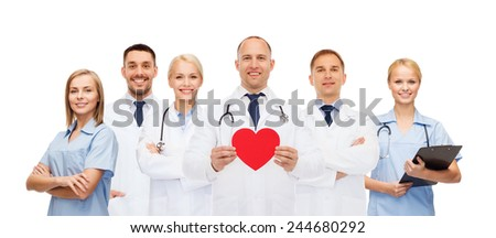 medicine, profession, teamwork and healthcare concept - group of smiling medics or doctors holding red paper heart shape, clipboard and stethoscopes over white background - stock photo