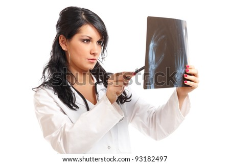 Medicine woman doctor looking at an x-ray - stock photo