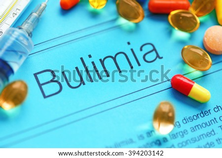 Medicines and Bulimia diagnosis written on paper closeup - stock photo