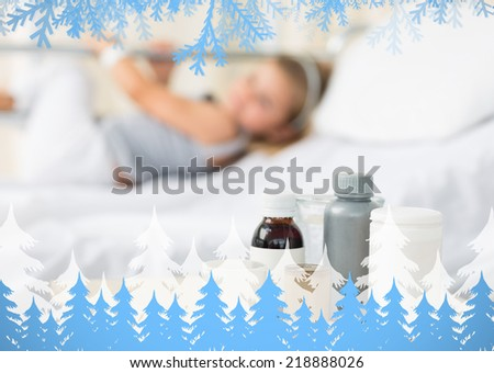Medicines on table with girl in hospital against frost and fir trees - stock photo
