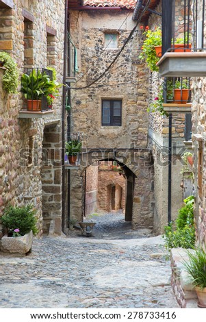 Medieval arched street in the old town of spain - stock photo