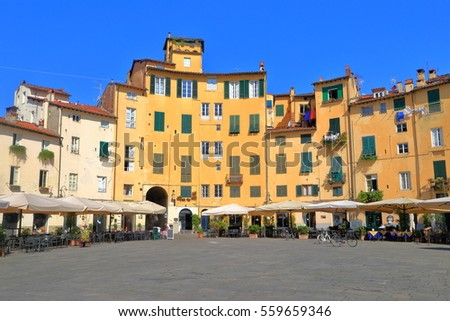 Medieval architecture in Piazza dell'Anfiteatro, public square inside the walled center of Lucca, region of Tuscany, Italy