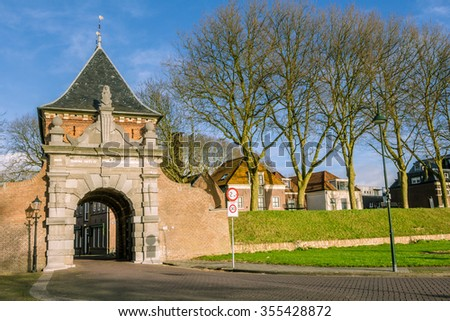 Medieval archway to the port of the picturesque village Schoonhoven near the river Lek in the Netherlands - stock photo