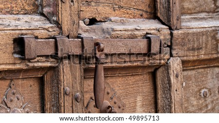 Medieval bolt and door - stock photo