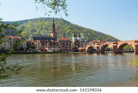 Medieval bridge leading into old town of Heidelberg Germany from riverbank of River Neckar