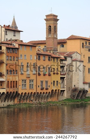 Medieval buildings along the banks of the Arno River in Florence, Italy - stock photo