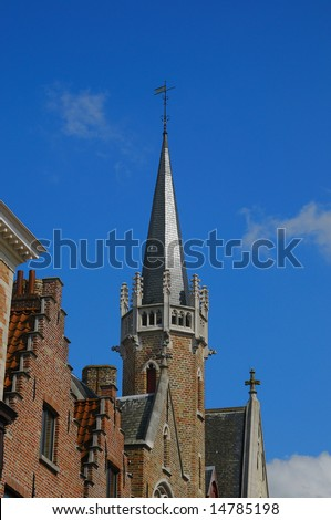 Medieval buildings in historical center of Brugge in sunny day, Belgium
