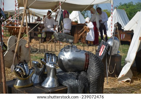 medieval camp with armor - stock photo