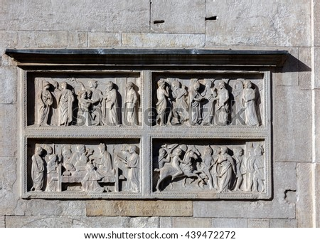 Medieval carvings on the facade of the Modena's cathedral, a UNESCO World Heritage Site in Modena, Italy - stock photo