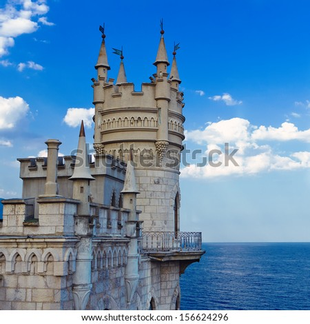 Medieval castle against blue sky with clouds. Swallow's Nest, The Crimean Peninsula. - stock photo