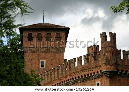 Medieval castle and tower built as imitation of real medieval castle for exhibition - stock photo