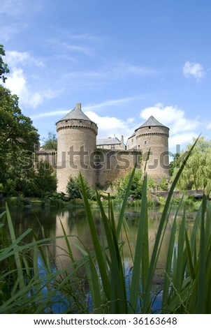 Medieval castle in France on bright sunny day  - stock photo