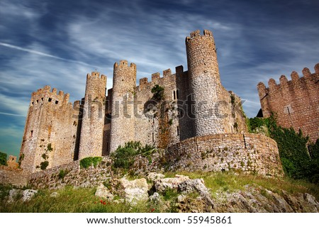 Medieval castle in the portuguese village of Obidos - stock photo