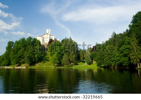 Medieval castle over lake scene - stock photo