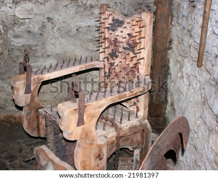 medieval chair for tortures - stock photo