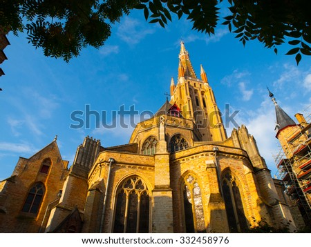 Medieval Church of Our Lady in Bruges in sunny day, Belgium - stock photo