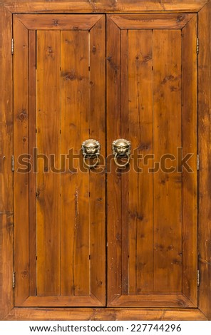 Medieval closed wooden doors with handles - stock photo
