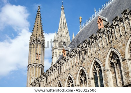Medieval Cloth Hall and spires of St. Martin's Cathedral in Ypres (Ieper), Belgium, which were reconstructed following the destruction of World War I