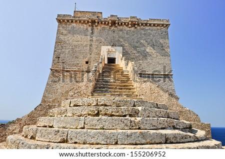 Medieval coastal tower called Torre dell'Alto, built in 16th century, in natural park of Porto Selvaggio in Salento, Apulia. Italy. - stock photo