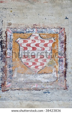 Medieval coat of arms on stone wall - Florence, Italy