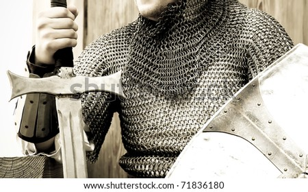 Medieval crusader knight with sword and shield. - stock photo