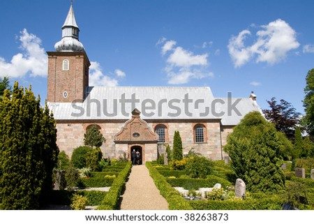 medieval danish church and graveyard. old religious building in denmark - stock photo