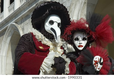 Medieval Doctor dressed with birds beak for Carnivale in Venice,Italy and standing in St Marks Square - stock photo