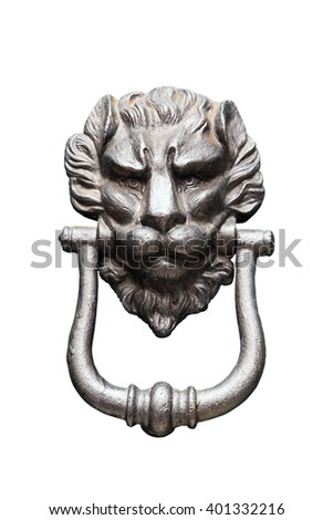 Medieval door knocker in a form of iron lion head isolated closeup on white background