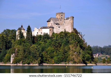 Medieval Dunajec Castle in Niedzica, Poland. Built in 14th century, partly ruined.  - stock photo