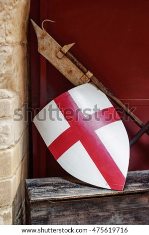 Medieval England flag shield and weapon resting on the wall side