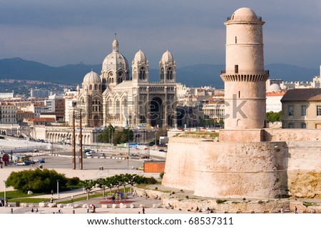 Medieval Fortress and cathedral on the waterfront in Marseille France - stock photo