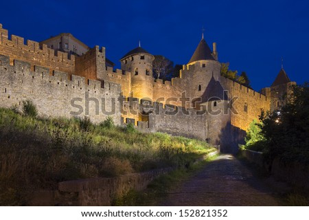 Medieval fortress and walled city of Carcassonne in the Languedoc-Roussillon region of south west France. Restored in 1853 and now a UNESCO World Heritage Site. - stock photo