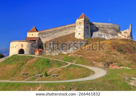 Medieval fortress built on a hilltop in Rasnov, Transylvania, Romania  - stock photo