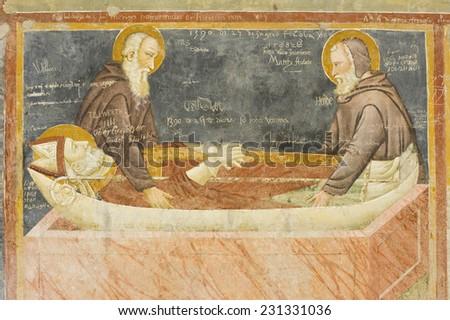 Medieval frescos with graffiti as old as the 14th century. Basilica of San Zeno, Verona, Italy. - stock photo