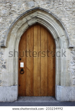 Medieval front door in the downtown of London, UK - stock photo