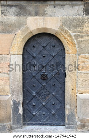 Medieval front door in the downtown of Prague, Czech Republic - stock photo
